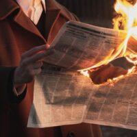 flaming newpaper